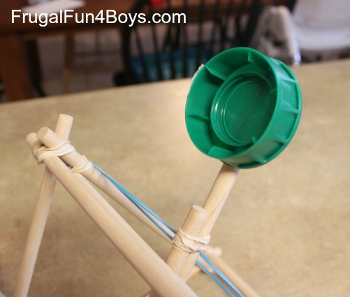 How to build a catapult out of dowel rods and rubber bands.