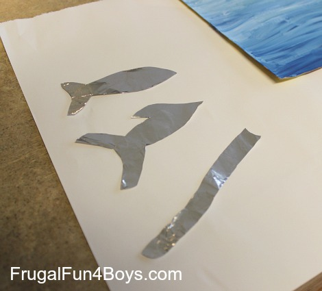 Make under the sea paintings with foil fish!