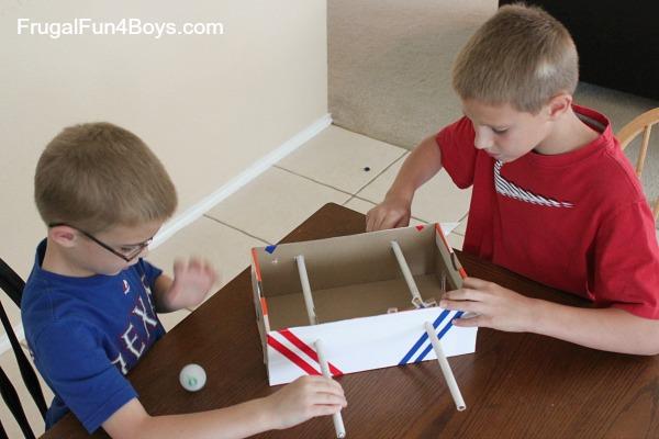 Build a shoebox foosball game