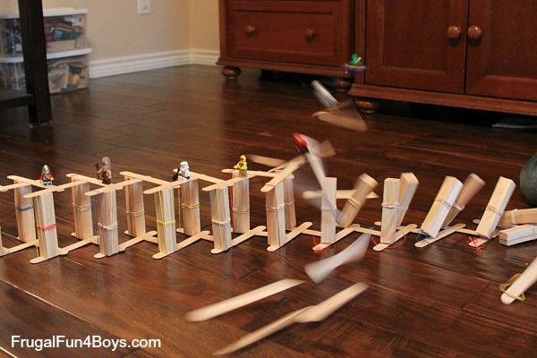 Build a chain reaction our of popsicle/craft sticks