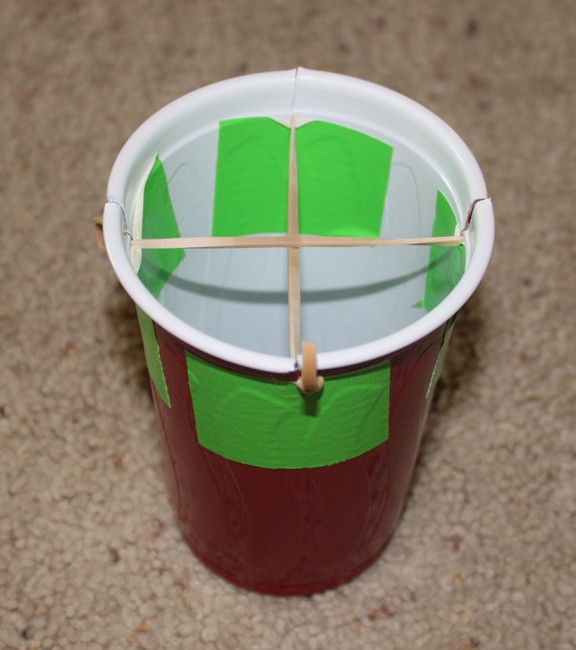 To Make One Cut 4 Slits In The Top Rim Of A Plastic Cup They Should Be About 1 2 Inch Long Put Piece Tape Under Each Slit