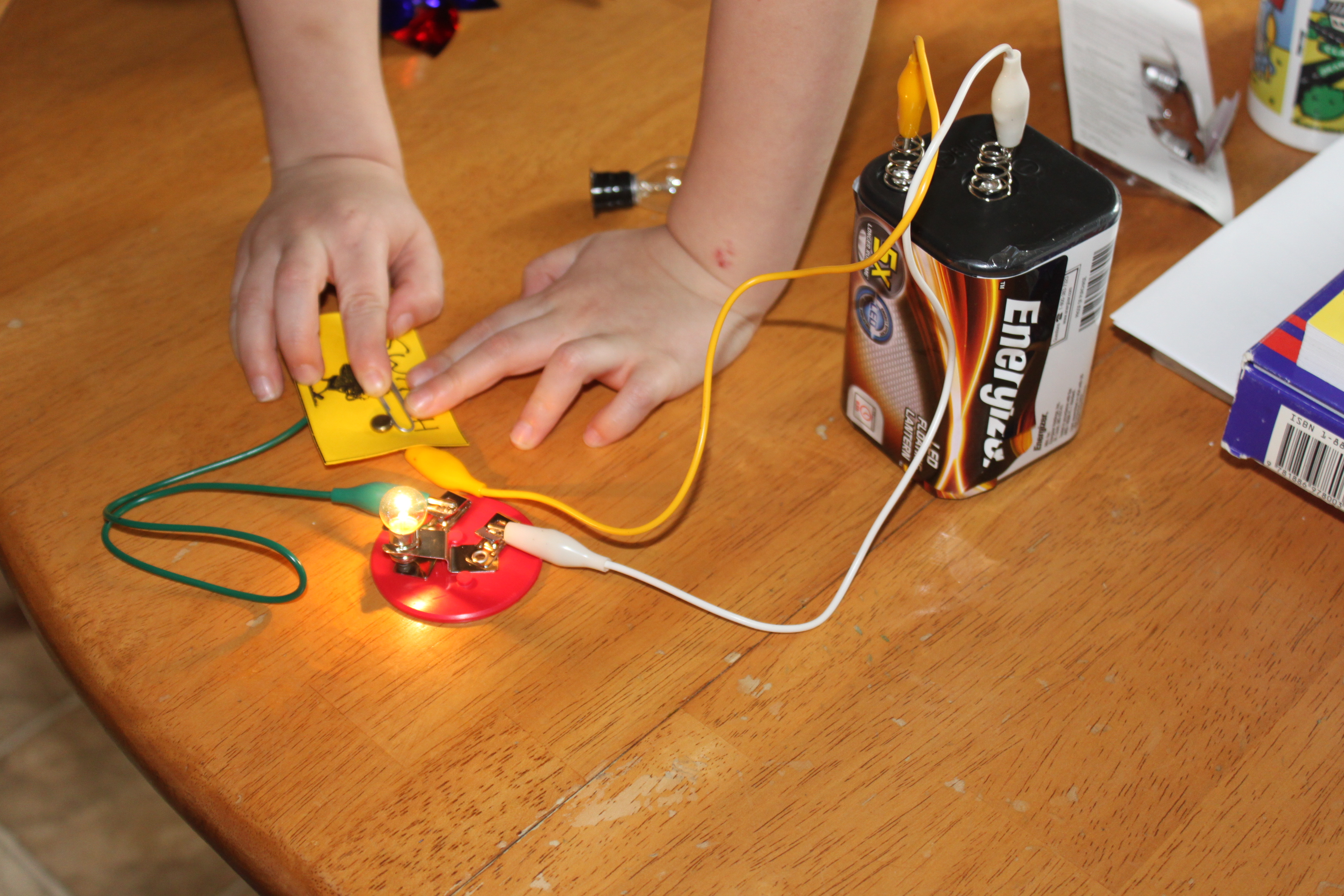 Electricity Experiments For Kids Frugal Fun Boys And Girls Simple Circuit Diagram Ks1 To Make A You Need Copper Wire 6 Volt Lantern Battery Alligator Clips Lightbulb