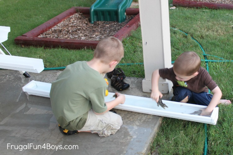 Inexpensive Backyard Play With Rain Gutters And Drain Pipe