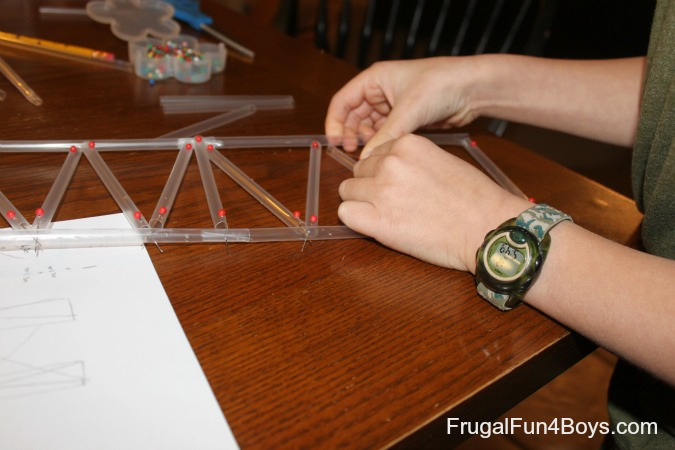 Build a bridge with straws and straight pins