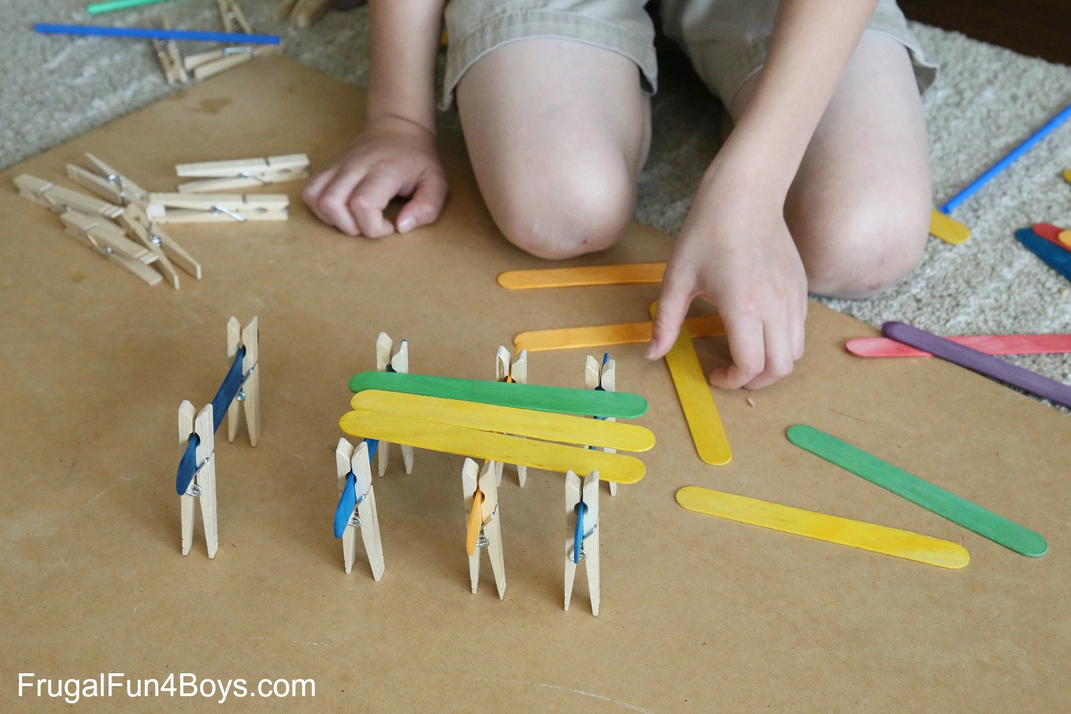 5 engineering challenges with clothespins binder clips and craft sticks. Black Bedroom Furniture Sets. Home Design Ideas