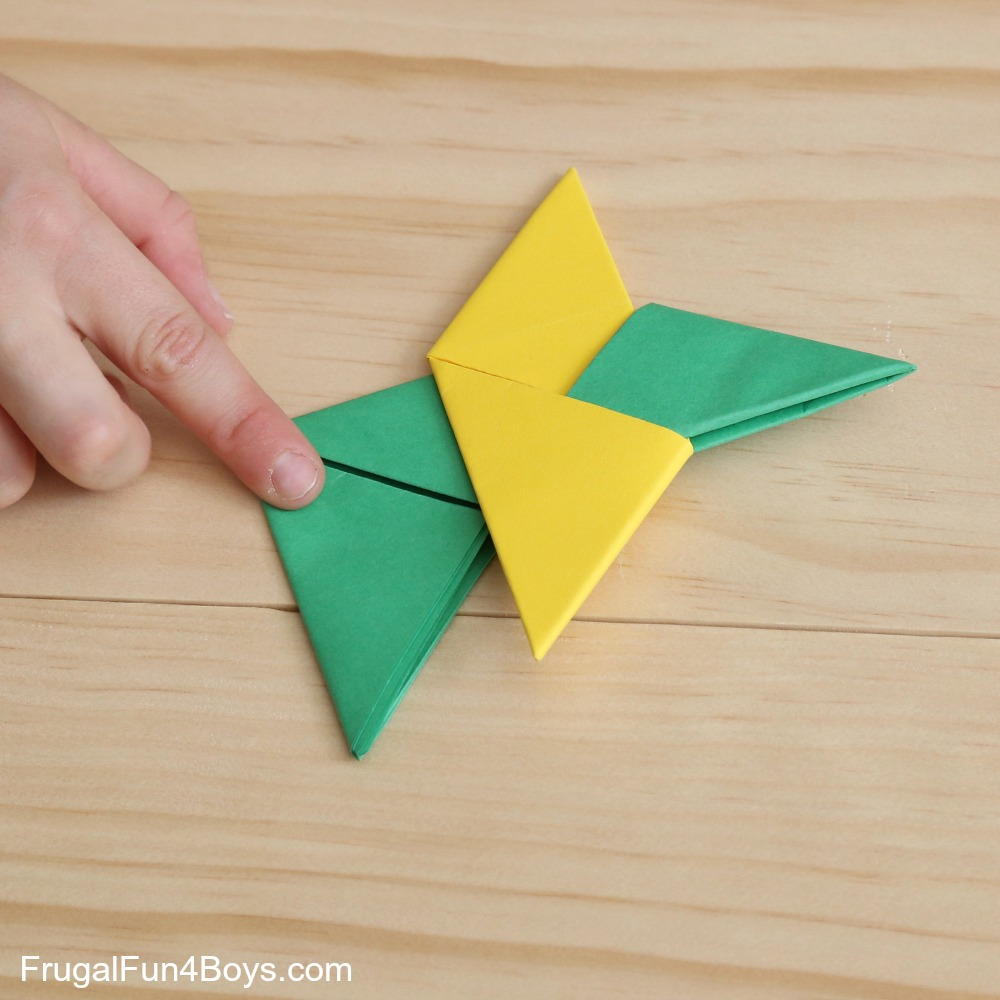 How To Fold Paper Ninja Stars Frugal Fun For Boys And Girls Origami Christmas Bird Feeder Diagram Step 12 Flip Over The Star In Green Points Same Way