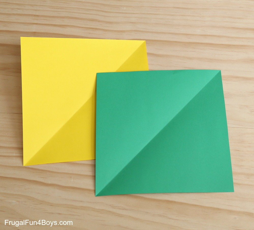 Step 2 Fold Each Square Piece Of Paper In Half To Make A Crease Down The Center