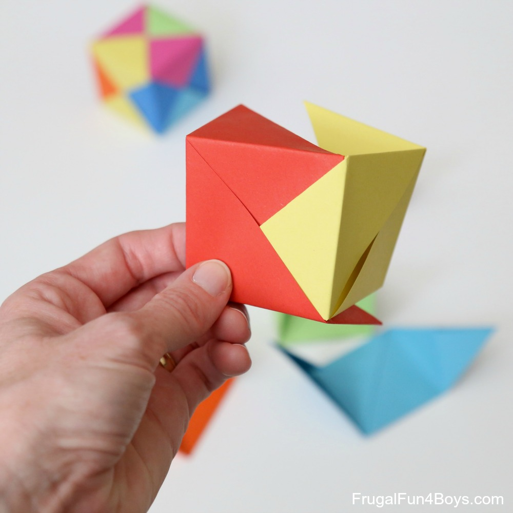 How To Fold Origami Paper Cubes Frugal Fun For Boys And Girls Hard Diagram Step 9 Now Its Time Start Fitting The Pieces Together Slide End Flap Of One Piece Into Center Another